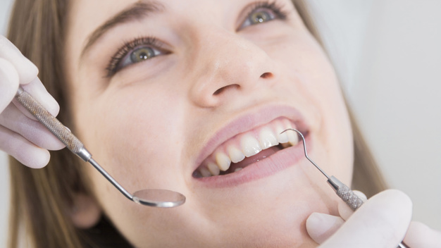 woman-having-teeth-examined-dentists_23-2147879263